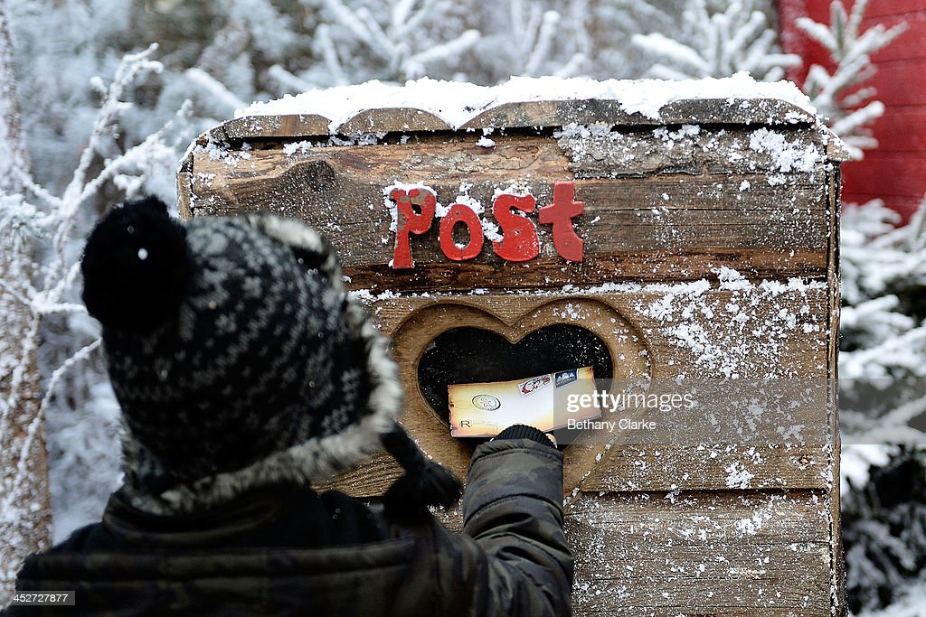 Laplanduk opens its doors for visitors photos and images getty images a child posts a letter to santa in the elf village on november 30 2013 spiritdancerdesigns Image collections