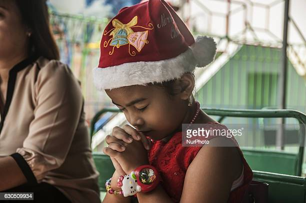 A child pray when children attend mass in celebration of Christmas in Sacred Heart of Jesus Catholic Church in Yogyakarta Indonesia on December 25...