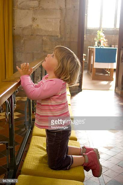 child praying - chapel stock pictures, royalty-free photos & images
