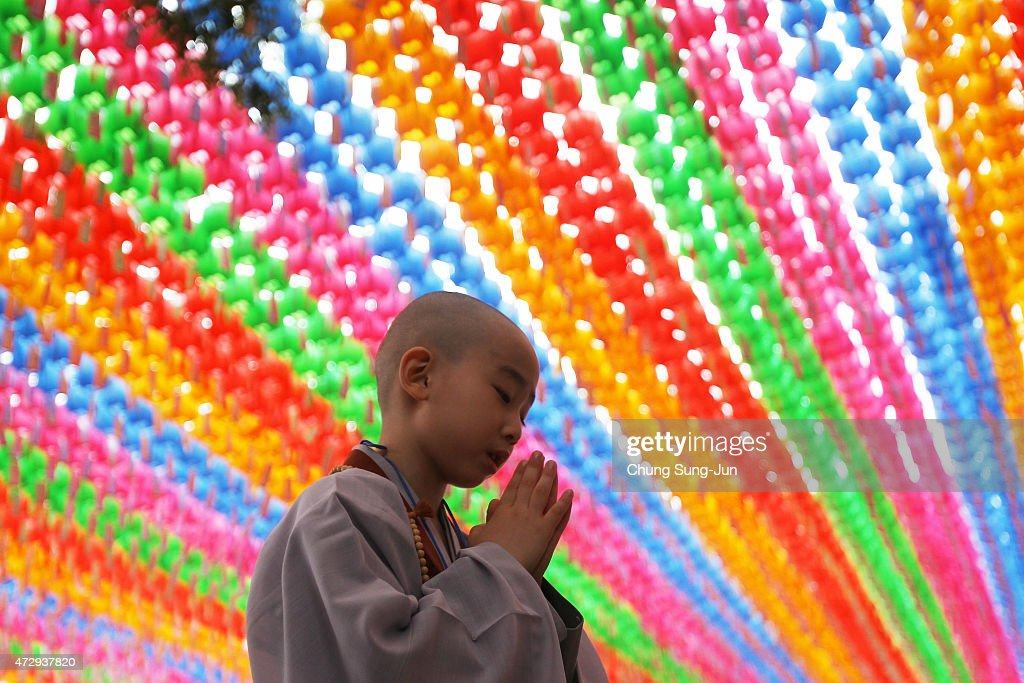 A child prays during the 'Children Becoming Buddhist Monks' ceremony forthcoming buddha's birthday at a Chogye temple on May 11, 2015 in Seoul, South Korea. Children have their hair shaved off during the 'Children Becoming Buddhist Monks' ceremony ahead of buddha's birthday at a Chogye temple. The children will stay at the temple to learn about Buddhism for 14 days. Buddha was born approximately 2,559 years ago, and although the exact date is unknown, Buddha's official birthday is celebrated on the full moon in May in South Korea, which is on May 25 this year.
