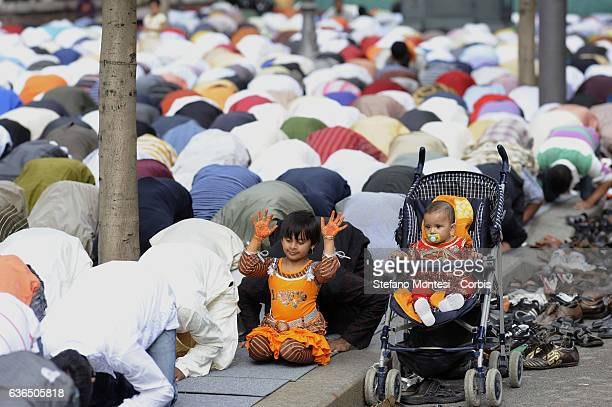 Child prays together with adults during prayerfor the Eid alFitr prayer that mark the end of the fasting month of Ramadan in Piazza Vittorio square...