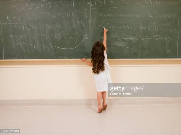 Child Prodigy Writing on Blackboard