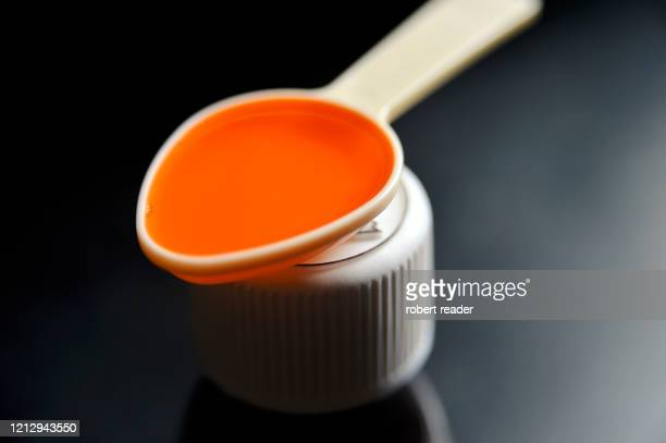 child proof medicine bottle cap and medicine - ibuprofen stock pictures, royalty-free photos & images