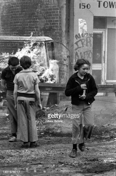 Child protects a religious icon during rioting in the Lower Falls Road, Belfast, 17th September 1976.