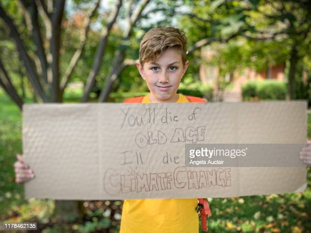 child protesting climate change - striker stock pictures, royalty-free photos & images