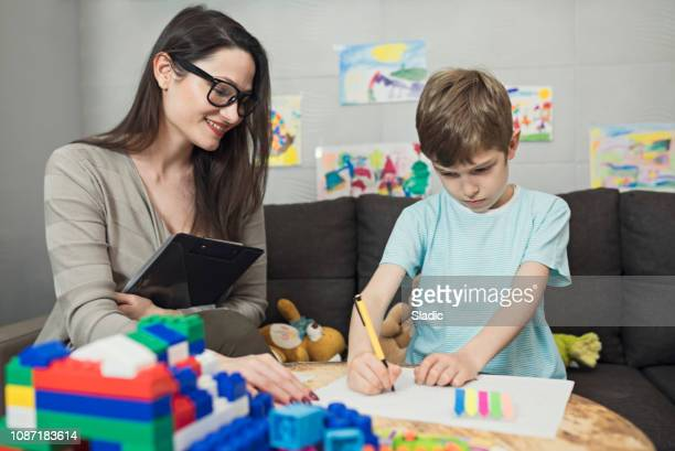 child psychologist at work - alternative therapy stock pictures, royalty-free photos & images