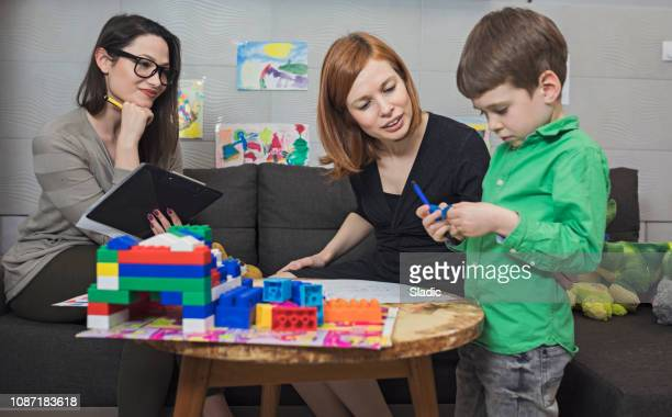 child psychologist at work - psychotherapy stock pictures, royalty-free photos & images