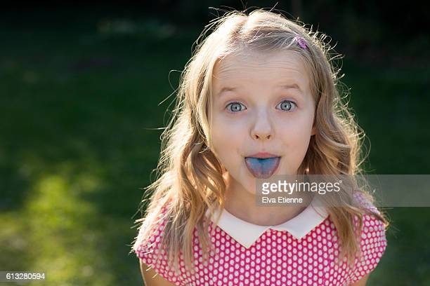 Child pulling blue stained tongue