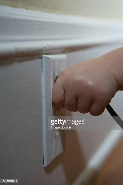 Child pulling plug