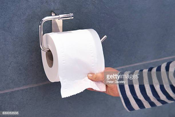 child pulling toilet roll - toilet paper stock pictures, royalty-free photos & images