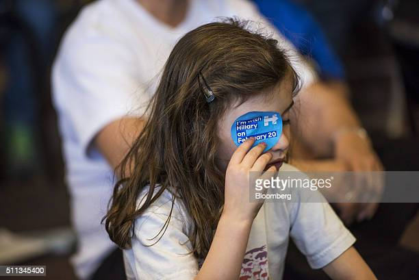 A child puts a campaign sticker on her eye as she listens to Chelsea Clinton daughter of 2016 Democratic presidential candidate Hillary Clinton not...