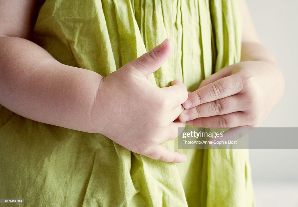 Child putting hands on stomach : Stock Photo