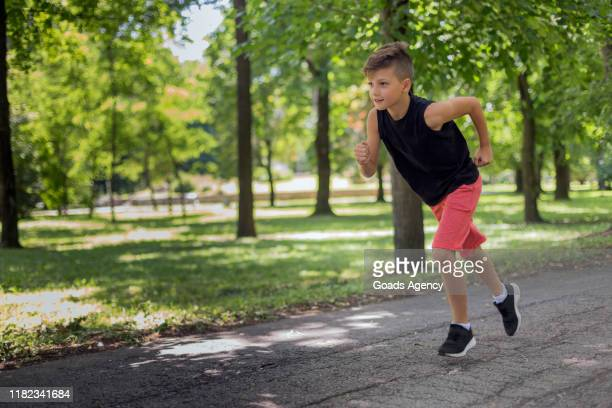child race running - sportswear stock pictures, royalty-free photos & images