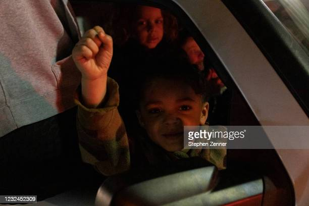 Child raises fist in car during a protest in reaction to the police shooting of MaKhia Bryant, 16 on April 21 in Columbus, Ohio. Black Lives Matter...