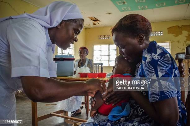 Child reacts as he receives an injection during the nationwide vaccination campaign against measles, rubella and polio targeting all children under...