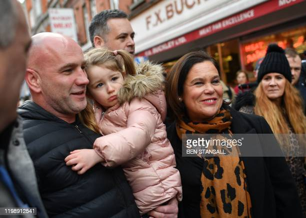 A child reacts as Sinn Fein President Mary Lou McDonald tries to pose whilst canvassing for support in Dublin on February 6 ahead of the February 8...