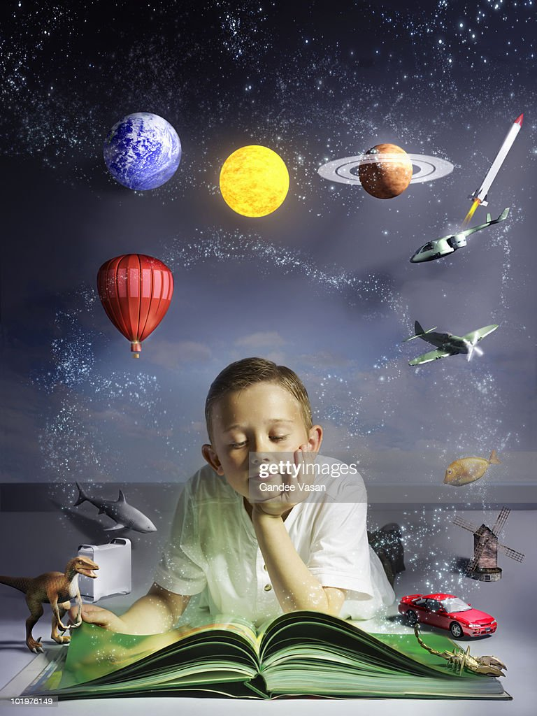 Child reading book with his imagination coming to  : Stock Photo