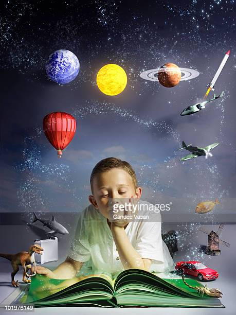 Child reading book with his imagination coming to