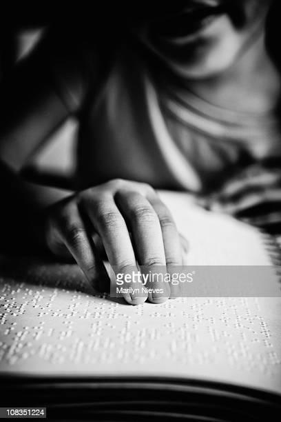 child reading braille