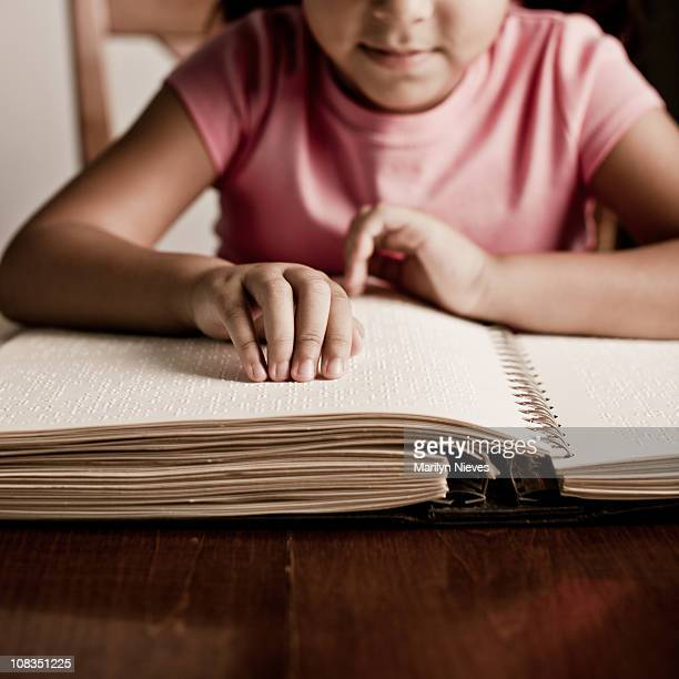 child reading braille - braille stock pictures, royalty-free photos & images