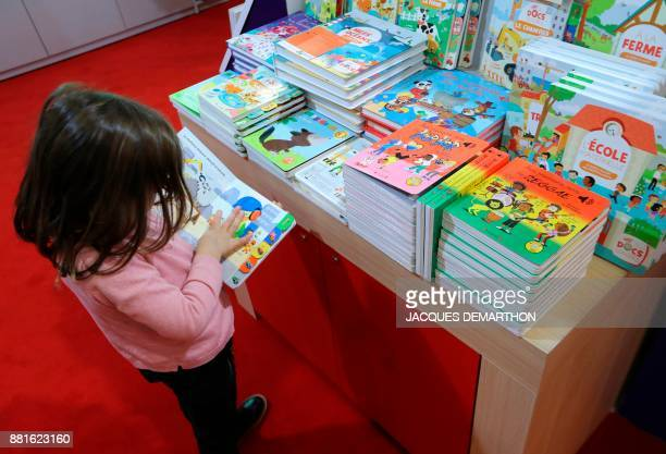 A child reads at the Salon du livre et de la presse jeunesse in Montreuil eastern Paris on November 29 2017 DEMARTHON