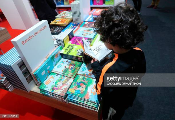 A child reads during the Salon du livre et de la presse jeunesse in Montreuil eastern Paris on November 29 2017 DEMARTHON