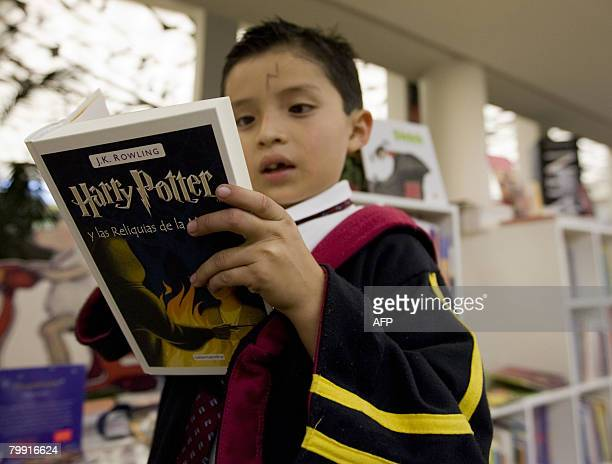 A child reads Harry Potter and the Deadly Hollows the new book in the Harry Potter series by author J K Rowling at a bookshop in Mexico City on...