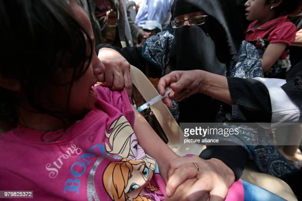 A child receives a diphtheria vaccine during a vaccination campaign in Sanaa Yemen 14 March 2018 Photo Hani AlAnsi/dpa