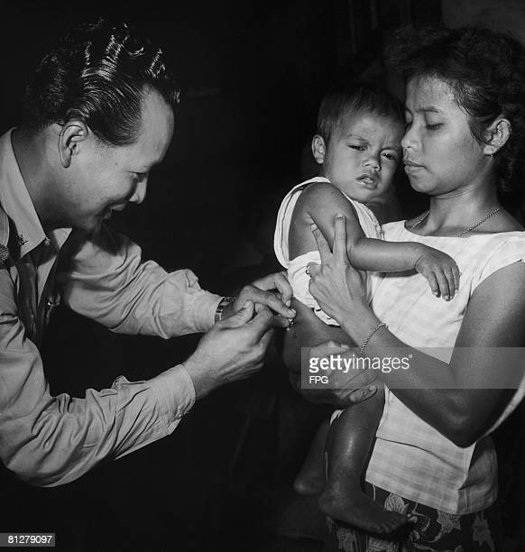 A child receives a DPT triple immunization against diphtheria whooping cough and tetanus on the island of Ko Samui circa 1950