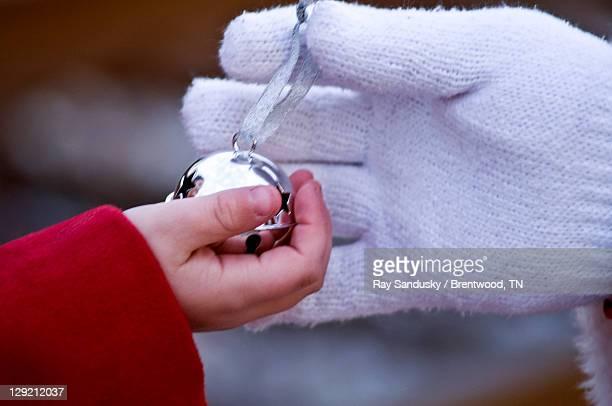 Child recieving bell