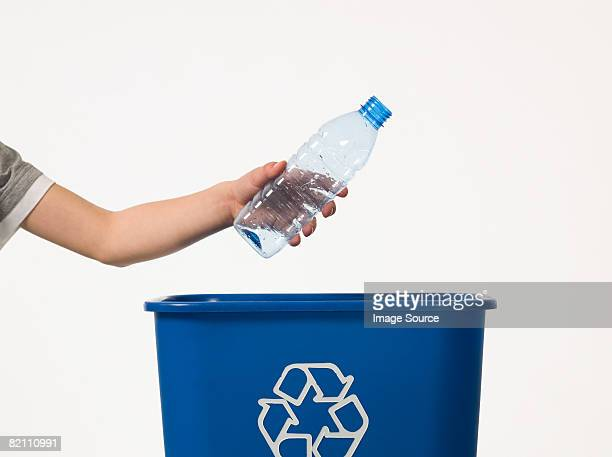 child recycling a bottle - garbage bin stock pictures, royalty-free photos & images
