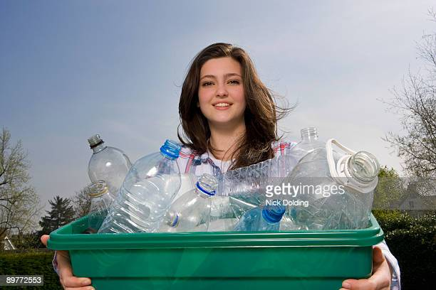 child recycling at home - morality stock photos and pictures