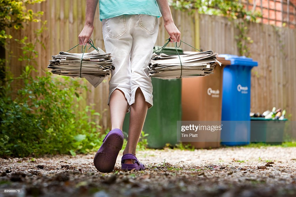 Child recycling newspapers. : Stock Photo