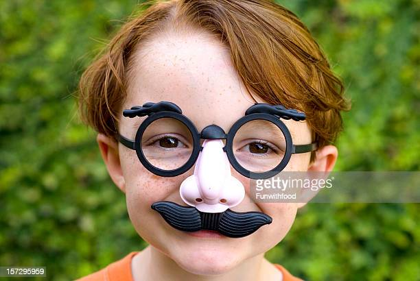 child redhead boy, disguise & glasses making funny face, halloween costume - nose mask stock pictures, royalty-free photos & images