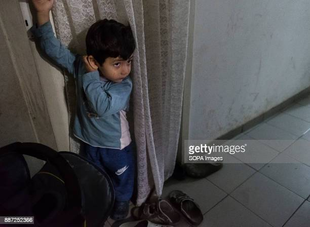CAMP KRNJACA BELGRADE SERBIA A child refugee from Uzbekistan waits for his mother to return from another room With Hungary and Croatia stopping...