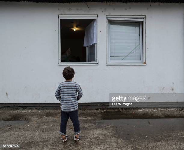 CAMP KRNJACA BELGRADE SERBIA A child refugee looks up towards the window of a room he shares with his family in a Serbian refugee camp With Hungary...