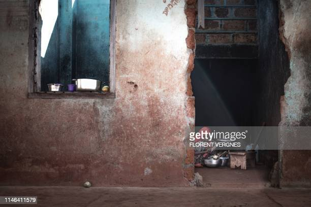 """Child returned from the IDP camp of the """"Petit Seminaire"""" is cooking in her ruined house in the Tokoyo district of Bangassou on May 17, 2019. - In..."""