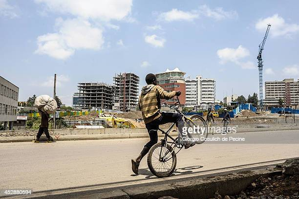 A child rides his bicycle near Kasancis district on July 03 2014 in Addis Ababa Ethiopia The Ethiopian government has recently launched a new urban...