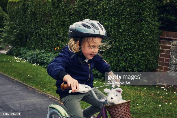 child riding a bicycle - determination stock pictures, royalty-free photos & images
