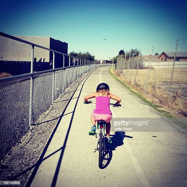 Child riding bike along designated cycle path