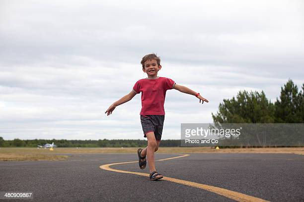 child running on asphalt