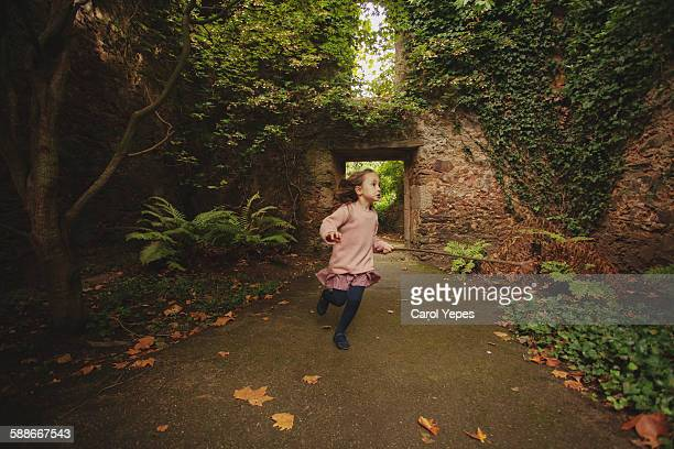 child runs on forested path autumn - runaway stock photos and pictures