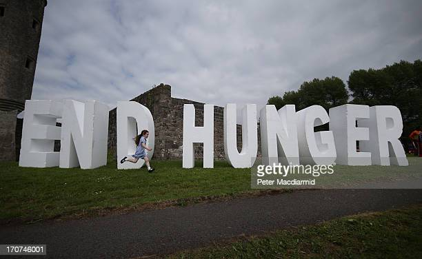 A child runs past a word sculpture calling for an end to hunger near the G8 Summit on June 17 2013 in Enniskillen Northern Ireland The two day G8...