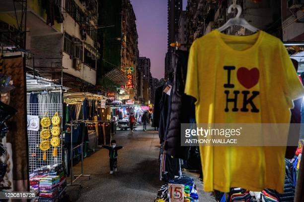 Child runs past street market stalls in the Sham Shui Po district of Kowloon in Hong Kong on January 27 one of the international business hub's...
