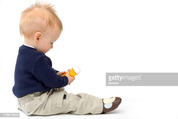 Child safety. Baby with medicine.