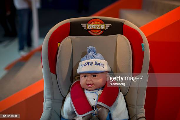 A child safety seat is displayed at the AutoHomecomcn booth at the 11th China International Automobile Exhibition in Guangzhou China on Thursday Nov...