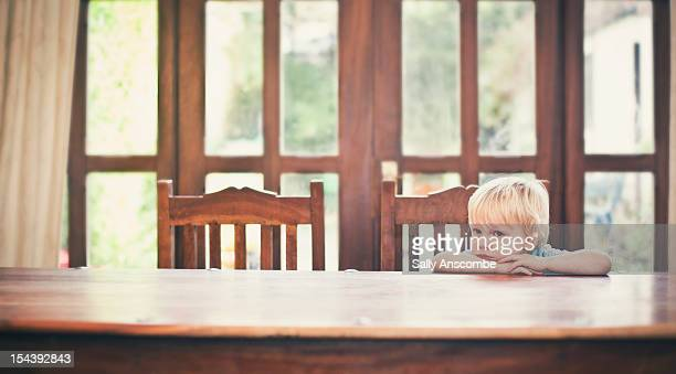 Child sat at the table