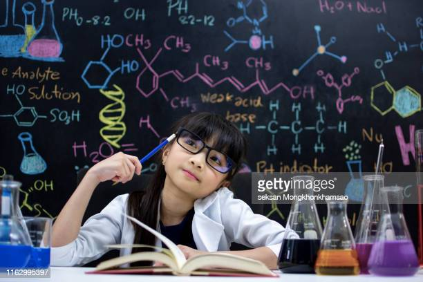 child science thinking - genius stock pictures, royalty-free photos & images