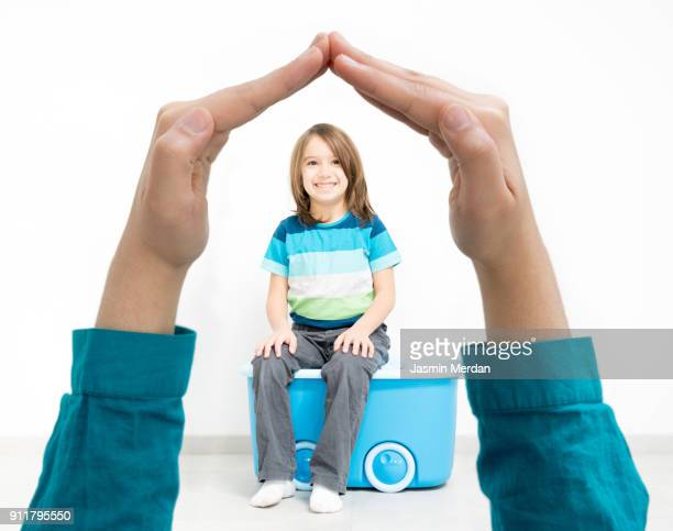 child secure and safe between parent's hands - guarding stock photos and pictures