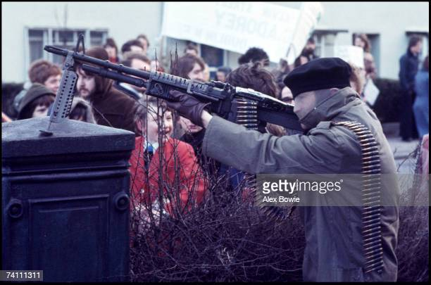 A child seems impressed by an IRA gunman during a demonstration in the republican Creggan estate in Londonderry to mark the 6th anniversary of Bloody...